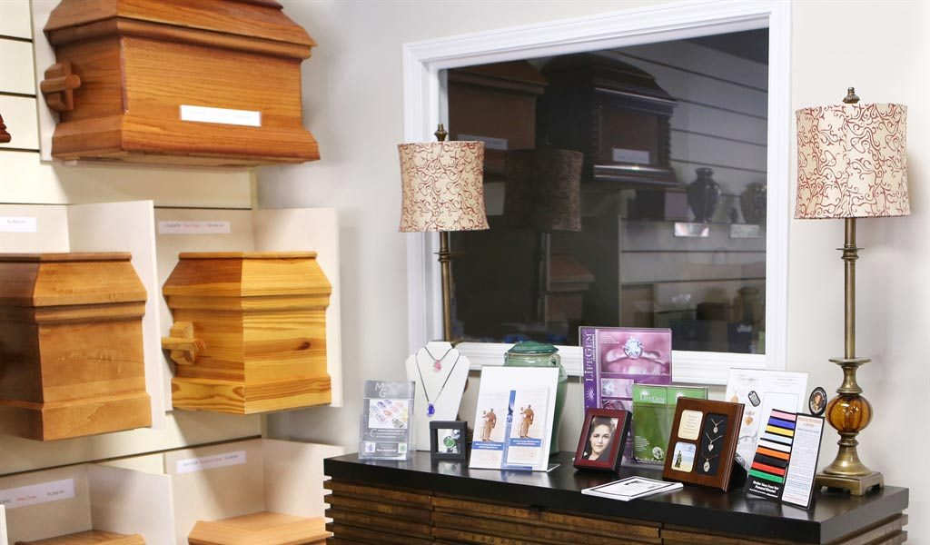 Caksets, jewelry, and cremation viewing window at Georgia Cremation